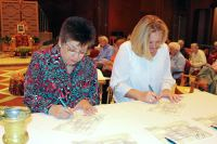 New Providence Associates Diana M. Garza and DeAnna Havel of Texas sign their commitment statements during their commitment ceremony at Saint Mary-of-the-Woods on Oct. 21, 2014.