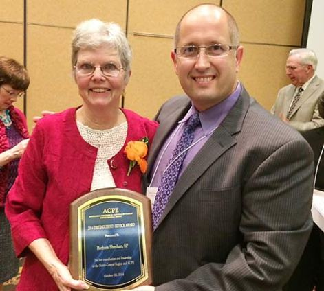 Sister Barbara Sheehan with Urban CPE Consortium, Inc., Board President Matt Smucker. In the background to the right is Sister Barbara's brother, Tom Sheehan.
