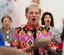 Director of Providence Associates Diane Mason sings during the entrance procession followed by Sister Ann Sullivan and Rev. Rebecca Zelensky.