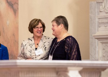 New Providence Associates Lorrie Scheidler and Marsha Bialaszewski greet each other after making commitments.