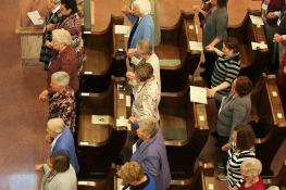 Sisters, Providence Associates and guests join hands during the praying of the Our Father prayer.