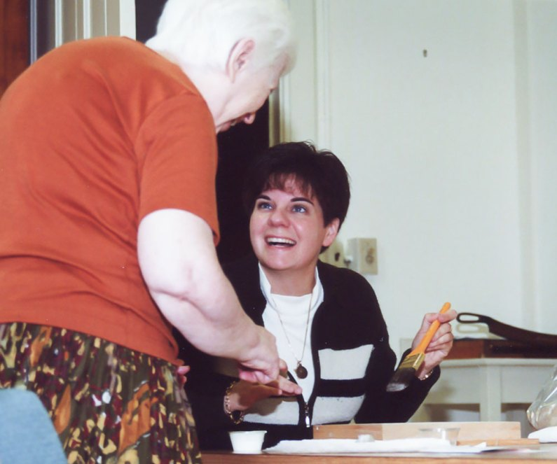 Here's Sister Regina in one of those first photos I took of her. In this photo taken three days after she entered the postulancy in September 2001, Regina is working on a craft project under the instruction of Sister Rose Michele Boudreau (RIP).