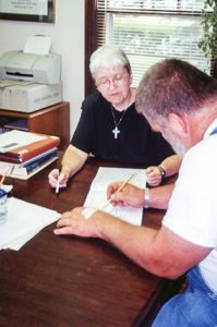 Sister Margaret Quinlan teaches an adult student in 2000.