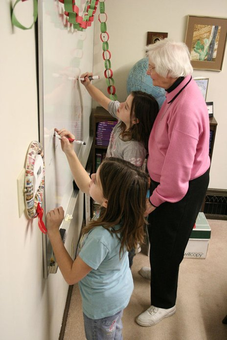 Double the math. Sister Charles Van Hoy works with twin students in 2008 in the after school tutoring program for EFS.