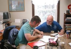 Volunteer tutor Ron Horndasch, right, helps adult student Dale Howk prepare for the military's ASVAB entrance test in 2011.