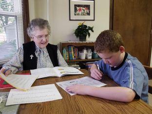 Sister Frances Joan Baker (RIP) tutors a young man after school at EFS in 2005.