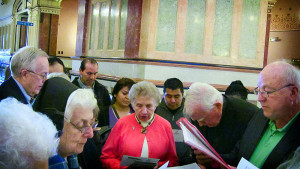 Sister Marilyn Kofler, center, joins Sisters and Brothers of Immigrants in a prayer service in the rotunda at the Illinois Capitol in Springfield in an effort to lobby for temporary driving licenses for new immigrants. (Submitted photo.)
