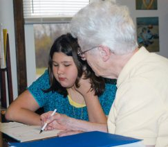 Sister Joseph Fillenwarth tutors a student in 2011.