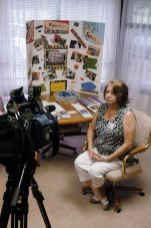 EFS Director Penny Sullivan prepares to be interviewed by the local news during an open house for the ministry in 2010.