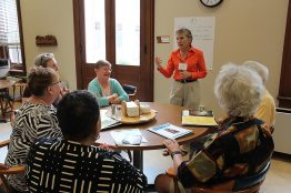 Providence Associate Maureen Baca of Albuquerque, New Mexico, (standing, shown here at a meeting of Providence Associates) strives to do her work as a consultant in a spirit of love, mercy and justice.