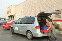 Ann Testa, summer gardener, delivers White Violet Center tomatoes to local grocery store, Baesler's Market, last year. WVC hopes to supply more restaurants and grocers in the future.