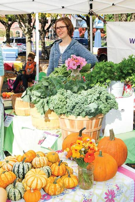 Candace Minster, garden manager and fiber projects coordinator, sells produce, flowers and other products from White Violet Center for Eco-Justice (WVC) at the Terre Haute Downtown Farmers' Market.