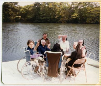 Wheelchairs on the dock! 1982 infirmary picnic.