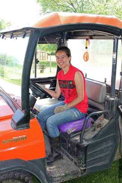 Intern Kaiolani Siregar takes the wheel of the Kubota, the UTV used to travel between pastures and haul manure for White Violet's rich compost