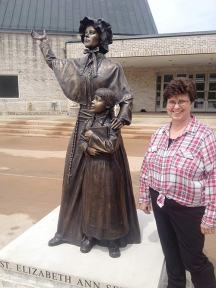 Sister Carole Kimes stands next to a sculpture of St. Elizabeth Ann Seton. Local sculptor Bill Wolfe created the piece.
