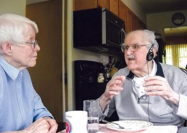 Sister Susan Dinnin, at left, enjoys an angel food treat with Stan Peloza to mark his 96th birthday. Sister Susan's care enables Stan to age in place in the home where he and his late wife lived for many years in Indianapolis.