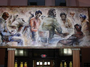 This mural by artist Mary Cobb hangs over the welcome desk at the men's homeless shelter in Louisville, Kentucky, where Providence Associate Maria Price serves as executive director.