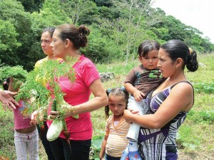 Nicaraguan women and children participate in the organic farming project Maria helps support.