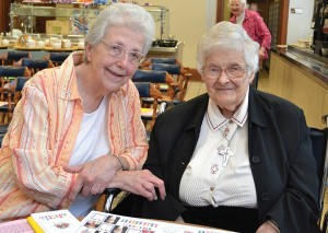 Sister Ann Casper (formerly Sister Kenneth Ann), accompanies Sister Mary Michael Lager, a celebrant at the Congregation's 90s and older party.