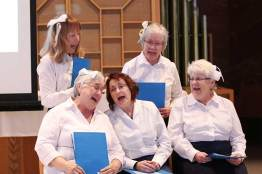 """2015: Providence Associates (front, from left) Sheila Donis, Sharon Michaud, Diann Neu, (back) Mel Wolff and Donna Kehoe performing in """"To God Through Music"""" skit"""