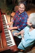 Sister Regina Marie McIntyre, right, gives music lessons to Sister Joni Luna who is in formation with the sisters.