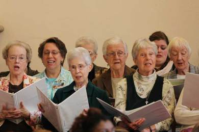Sister (from left) Carole Ann Fedders, Sisters of St. Francis Sister Donna Prickel, and Sisters Adele Beacham, Mary Ann McCauley, Jackie Hoffman and Joan Matthews along with others in the SCHOLA Choir during Mass
