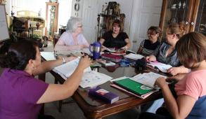 Sister Loretta Picucci, at left, teaches English to Mexican immigrants in one of their homes in southerin California as part of her ministry at Providence in the Desert