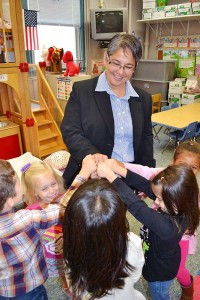 Sister Joni Luna receiving fist bumps from students at St. Patrick School.