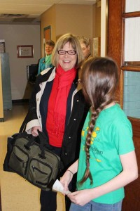 Sister Janice Smith is escorted by a St. Patrick School student to her destination.
