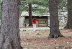 Providence Associate Candidate Joan Richards spends some reflective time during the Providence Associate spring retreat walking near the log cabin chapel on the grounds at Saint Mary-of-the-Woods.