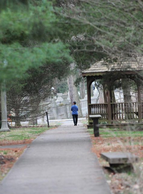 Providence Associate Maria Price walks toward the bridge during personal reflective time at the spring retreat.