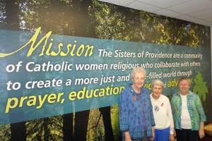 Sisters Ann Casper (from left), Rita Clare Gerardot and Donna Butler wear orange ribbons orange ribbons for Torture Awareness Month.