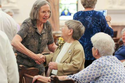 Sister Susanne Gallagher congratulates Golden Jubilarian Sister Cathy Campbell.