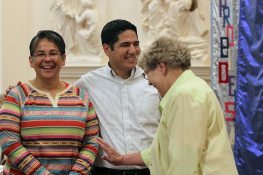 The newly professed Sister Joni Luna, left, laughs with her brother and with Sister Rose Ann Eaton after the ceremony.