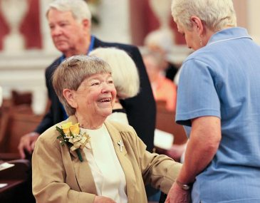 50-year jubilee celebrant Sister Cathy Campbell is greeted by a guest.