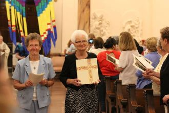 Sister Josephine Bryan and Barbara Ann Zeller participate in the opening procession.