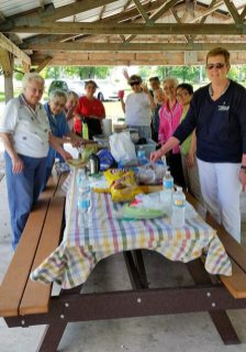 Picnic #1 on the way down in Earl Park, Indiana. From left, Sisters Dorothy Ellen Wolsiffer, Rose Marita Riordan, Teresa Costello, Joni Luna, Ann Paula Pohlman, Providence Associate Candidate Cindy Montgomery, Sister Joan Matthews, Sheila Donis, Sister My Huong Pham and Debbie Dillow.