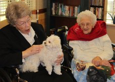 Sister Miriam Clare Stoll talks to Benny while Sister Mary Esther waits patiently for her turn.