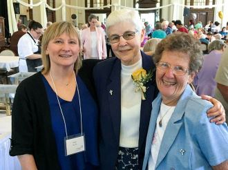 Providence Associate Suzie Ray at the Woods for the Providence Associate annual meeting visits with two of her first bosses again after 36 years. Sister Mary Jo Piccione, center, celebrates her golden jubilee and Sister Josephine Bryan.