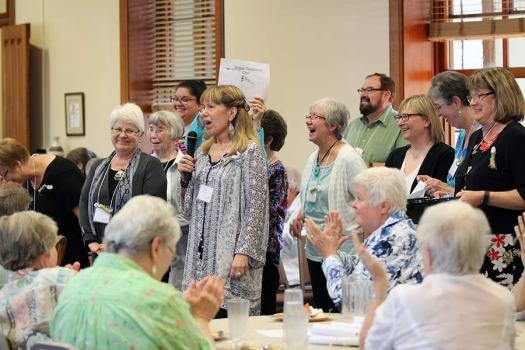 Providence Associates lead a lively song and dance for the sisters during the social supper with the sisters and associates. (photo by Amy Miranda)