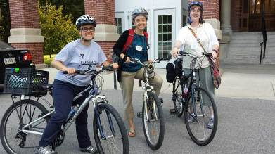 Sisters in initial formation, from left, Sisters Hannah Corbin, Tracey Horan and Arrianne Whittaker, take a bike ride in the evening after a long day at chapter. (photo by Sister Editha Ben)