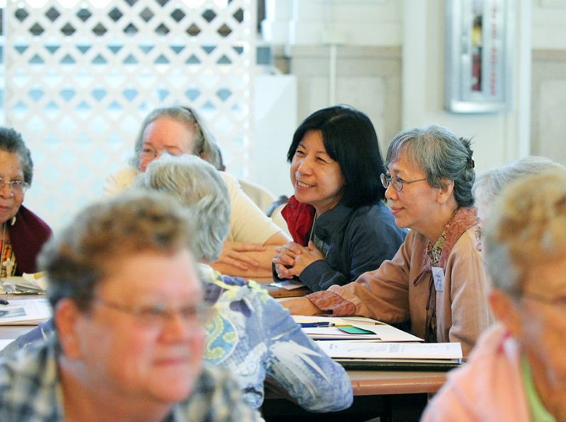 Sisters Norene Wu and Sophia Chen, home at the Woods from their mission in Taiwan, engage in table discussion. (photo by Amy Miranda)