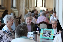 From left Sisters Mary Kay Duffy, Therese Guerin Sullivan and Helen Therese Conway engage in table discussion. (photo by Amy Miranda)