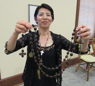 Sister Anna shows off her chaplet.