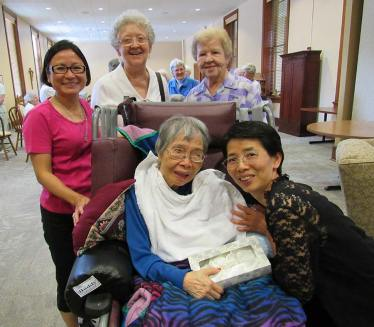 Sister Concetta Banez and Anna Fan, front, with Sisters My Huong Pham, Barbara Doherty and Nancy Nolan (back from left.)