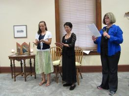 Novice Sisters Tracey Horan and Anna Fan pray after receiving their chaplets. Sister Janice Smith at right.