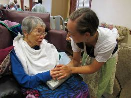Sister Tracey is greeted by Sister Concetta Banez after the blessing.