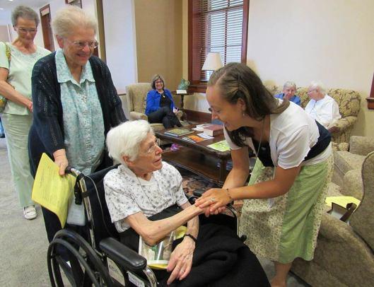 Sister Marie Grace Molloy accompanies Sister Martha Steidl to congratulate Sister Tracey.