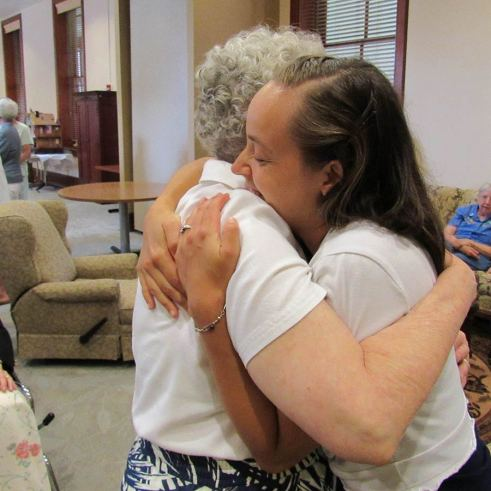 What's better than a hug from Sister Barbara Doherty? Sister Tracey Horan is congratulated after the blessing.