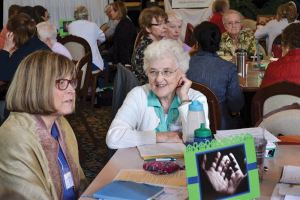 Sister Janice Smith, left, and Sister Patty Fillenwarth during table discussion at Chapter.